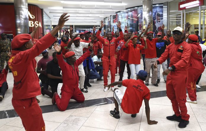 EFF members protest at the H&M store in the Mall of Africa