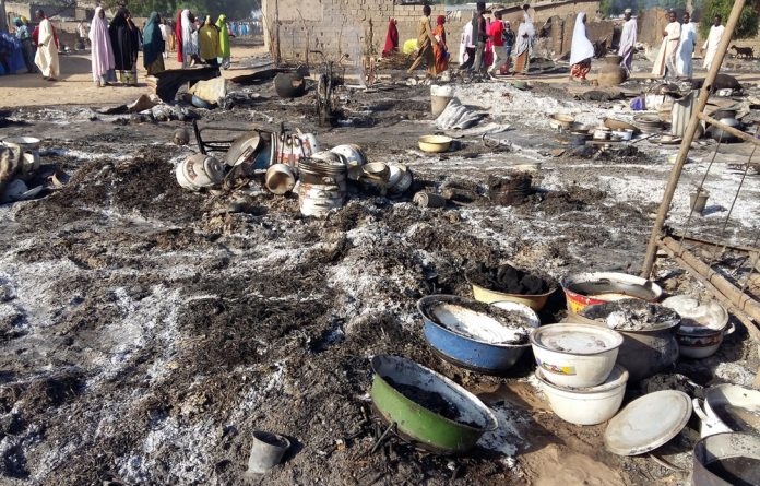 A general view shows the damage at a camp for displaced people after an attack by suspected members of the Islamist Boko Haram insurgency in Dalori