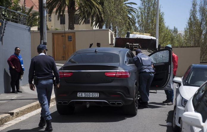 The two men were charged a day after Mihalik was shot dead outside Reddam House Atlantic Seaboard school in Green Point as he drove up to the school in his Mercedes-Benz on Tuesday morning.