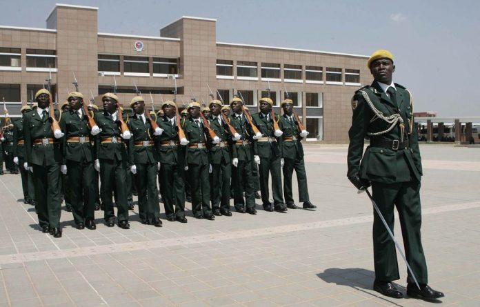 The opening of Zimbabwe's National Defence College. Government engineers say they were barred from inspecting the buildings.