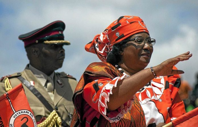 Malawi President Joyce Banda waves to the crowd gathered in Lilongwe for the official launch of her campaign.