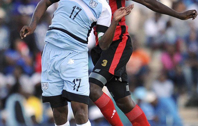 Head games: Botswana forward Joel Mogorosi