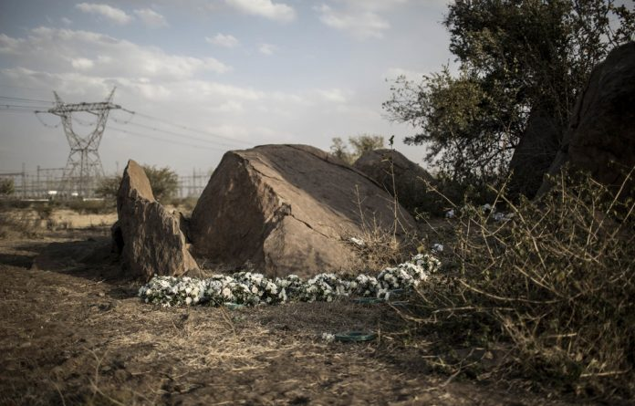 Flowers adorn the memorial site of the Marikana massacre on its fifth anniversary. No one has yet been tried for the mass shooting but this could change as new information comes to light.
