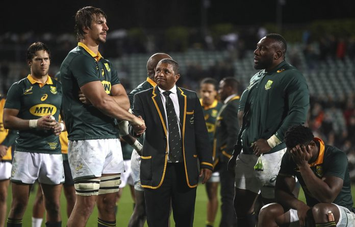 Tall order: Alister Coetzee consoles Springbok captain Eben Etzebeth after the drubbing by the All Blacks. The Boks are under extreme pressure to excel against the Wallabies on Saturday.