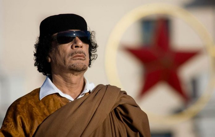 The new law bans anyone who held a post in or 'behaved' in a way that served and prolonged Muammar Gaddafi's regime.