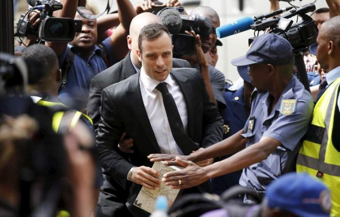 Voyeurs: The coverage of Oscar Pistorius may be a result of the prosecution promising a different story. Photo: Siphiwe Sibeko/Reuters