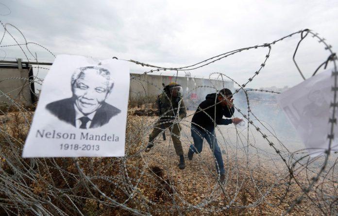 Thomas Ramahlo in front of his home in Winnie Mandela informal settlement in Tembisa.