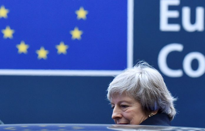 Theresa May leaves after a news conference following a European Union leaders summit in Brussels