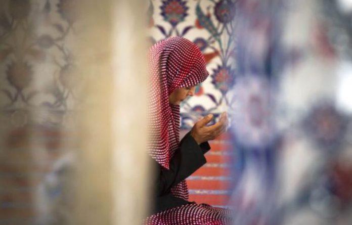A woman prays at the Nizamiye Masjid in Midrand. Despite the rainbow nation's liberal values