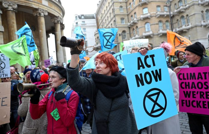 Protesters from the climate change pressure group Extinction Rebellion demonstrate.