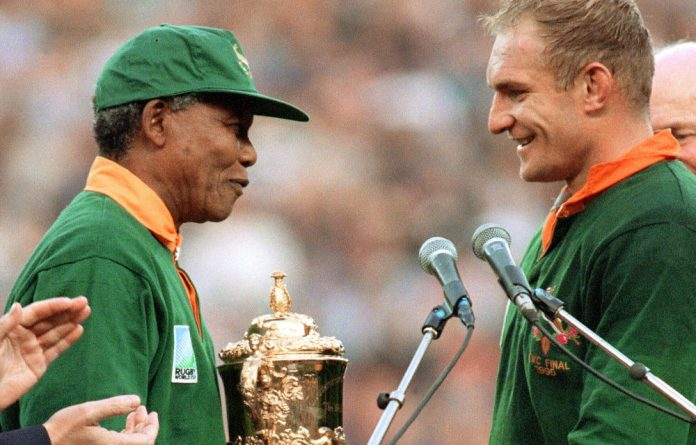 Former Springbok captain Francois Pienaar and Nelson Mandela.
