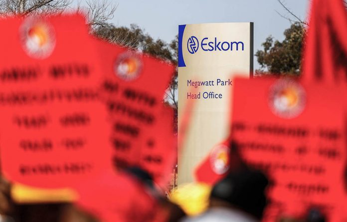 National Union of Mineworkers members at a previous protest outside Eskom's Megawatt Park in Johannesburg.