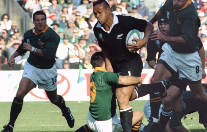 New Zealand winger Jonah Lomu is tackled by South African scrumhalf Joost Van der Westhuizen during the Rugby World Cup final played against New Zealand June 24