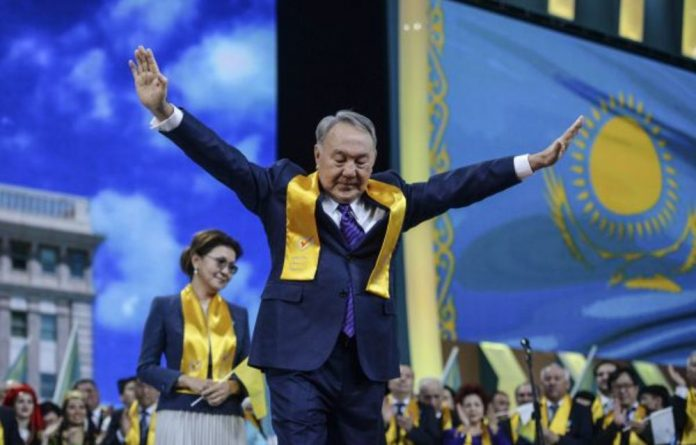 Lift-off: Nursultan Nazarbayev celebrates winning the national presidential elections in Kazakhstan in 2005. Election monitors said the polls were marred by widespread intimidation by the police and security forces.