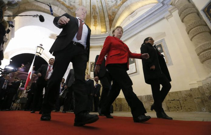 German Chancellor Angela Merkel leaves at the end of the European Union leaders summit in Valletta