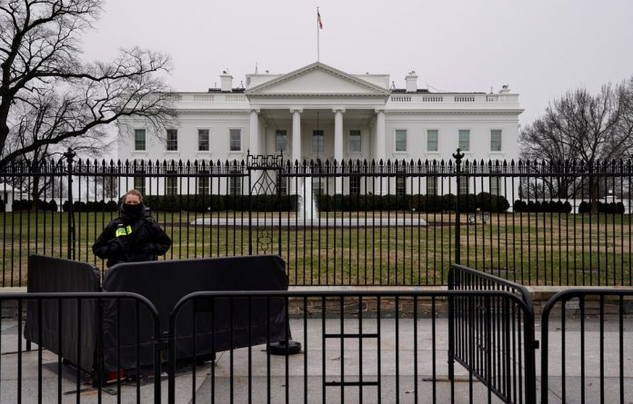 A Secret Service officer maintains watch during the partial government shutdown at the White House.