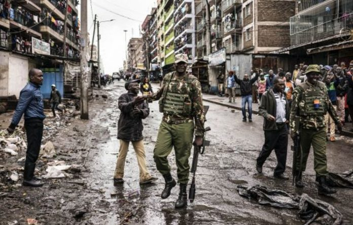 Kenyan police approach protesters opposing voting in Thursday's election — a vote that the opposition has shunned in light of the electoral commission's alleged unreliability.