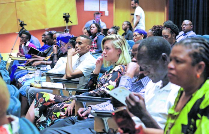 Audience members engage with the panelists at the Critical Thinking Forum which focused on Gender-Based Violence.