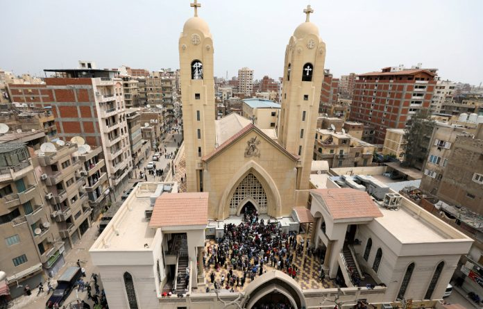 A general view is seen as Egyptians gather by a Coptic church that was bombed on Sunday in Tanta