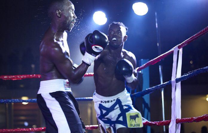 Future Olympian? Emile Kalekuzi knocking out his opponents in a Khayelitsha boxing ring