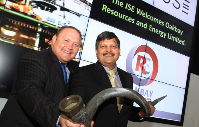 Oakbay Resources and Energy chief executive George van der Merwe and chairperson Atul Gupta at the JSE listing.