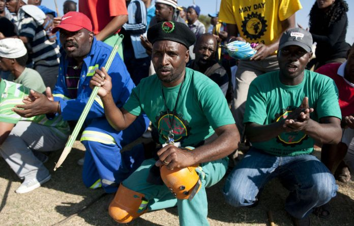 Workers downed tools demanding the immediate closure of the National Union of Mineworkers' offices at Lonmin.