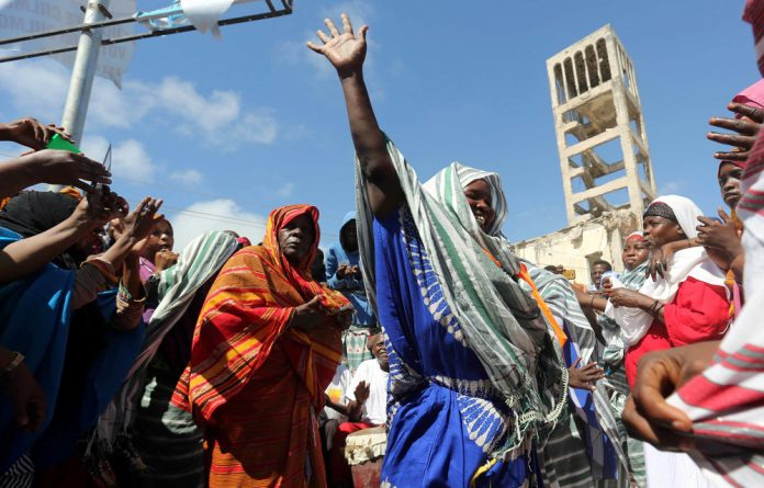In shambles: Somali women celebrate the election of President Mohamed Abdullahi Mohamed in 2017 but their joy is proving to be premature.