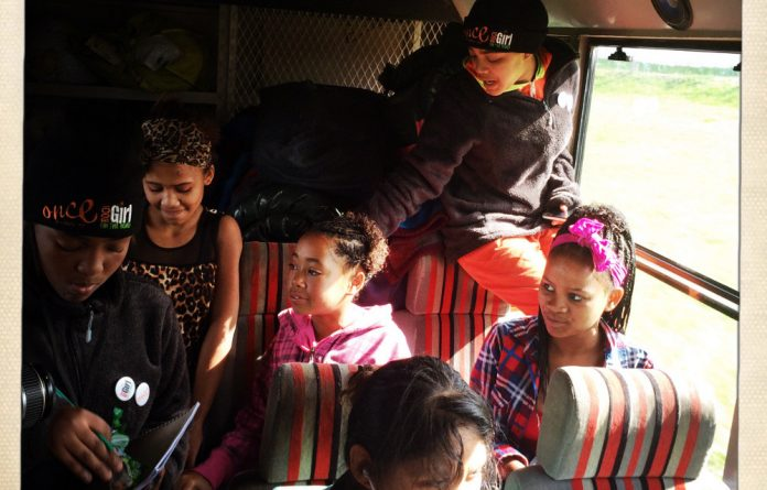 Some of the Rock Girls members on the overland vehicle on the second day of their first ever road trip seeing how other girls in South Africa live.