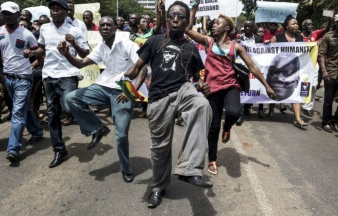 Demonstrators march to mark the one-year anniversary of the disappearance of journalist and political activist Itai Dzamara. He was abducted three years ago.
