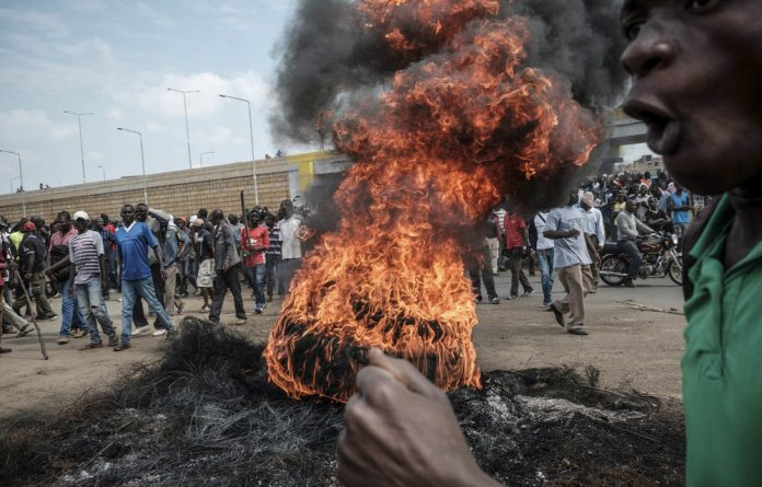 Fired up: Demonstrators in Kenya called for the removal of electoral commission officials