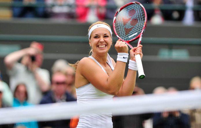 Sabine Lisicki celebrates beating Estonia's Kaia Kanepi during their women's singles quarterfinal match on day eight of the 2013 Wimbledon Championships.