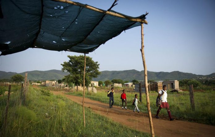 Struggle: Children in Jeppes Reef are only 2km from the Swazi border..