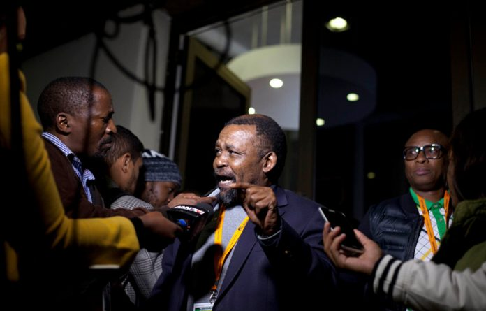 NEC member Joel Netshitenzhe briefs the media at the ANC's national policy conference.