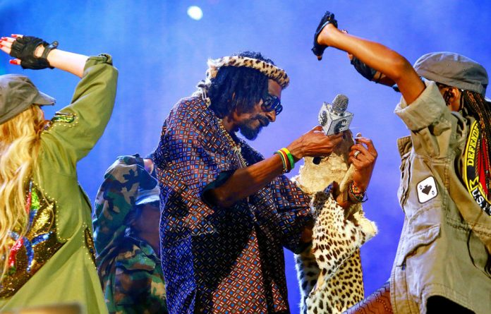 Snoop Lion performs during the inaugural MTV All Africa Stars Concert at Moses Mabhida Stadium in Durban on Saturday.