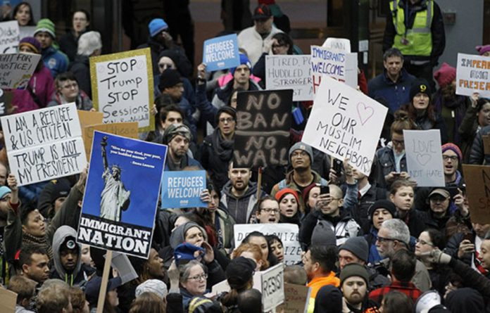 Activists gather at Portland International Airport to protest against President Donald Trump's executive action travel ban in Portland