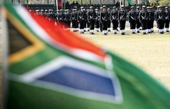 Female members of the SANDF take part in a parade at Thaba Tshwane to celebrate women's month.
