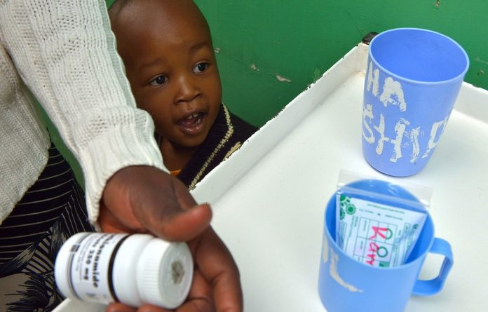 Children with tuberculosis have to take bitter-tasting medication which is also used for  adults.
