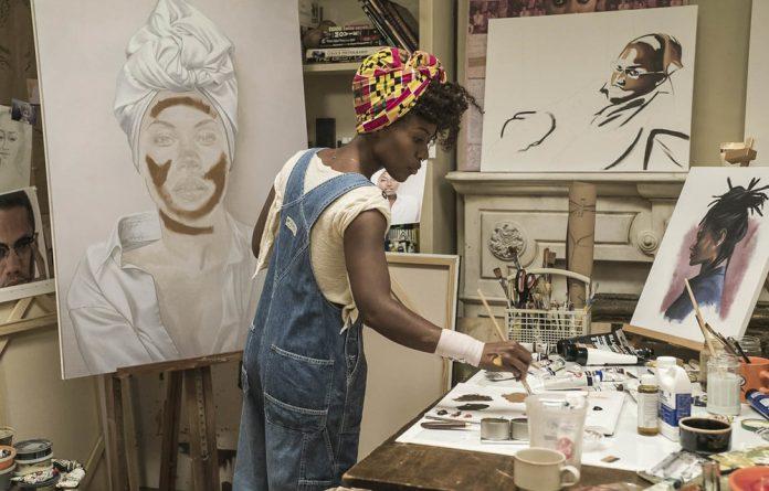 Loving: Nola Darling paints in her brownstone studio. Photos: David Lee/Netflix