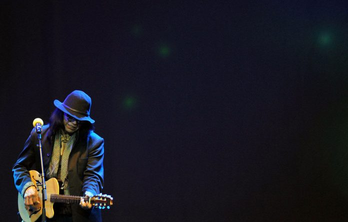 Sixto Rodriguez performs on stage at Carnival City
