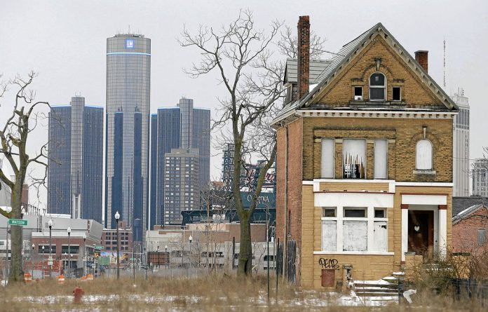 Haunted economy: Business in the debt-ridden city of Detroit
