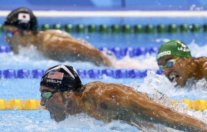 Michael phelps is eyed by Chad le Clos In the men's 200m butterfly swimming final at the Olympic Aquatics Stadium.