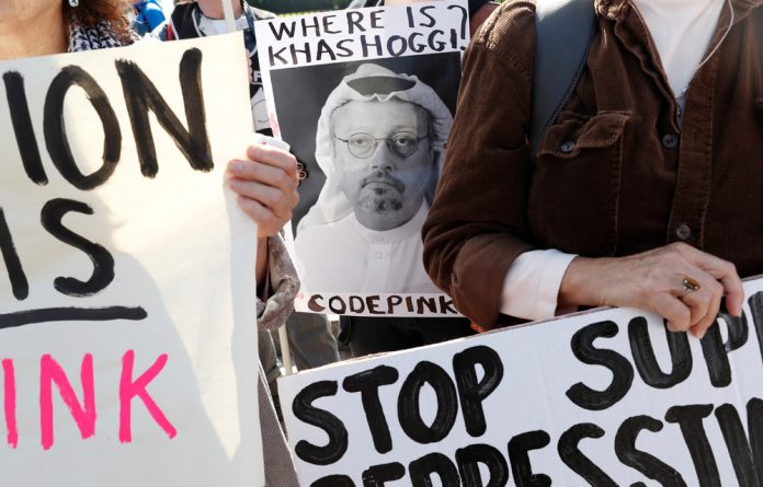 An activist holds an image of missing Saudi journalist Jamal Khashoggi during a demonstration calling for sanctions against Saudi Arabia and to protest Khashoggi's disappearance