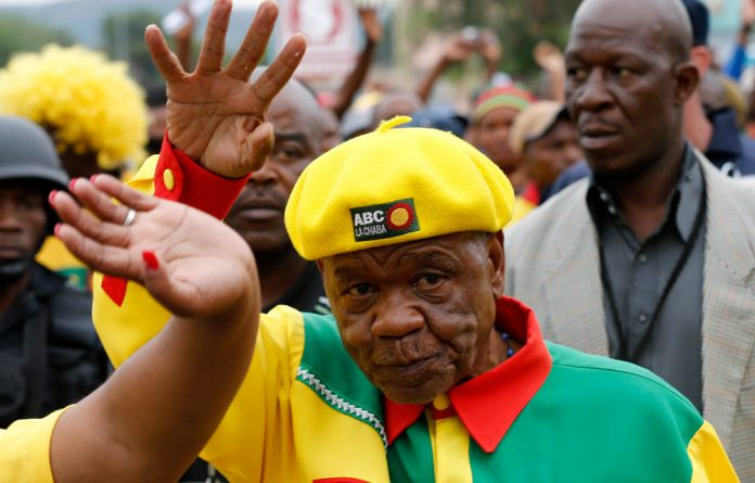 Thomas Thabane waves to his supporters during his walkabout in the capital Maseru.