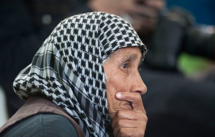 A woman listens to the sermon during the opening of the Open Mosque in Wynberg