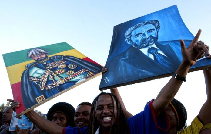 On a high: A Rastafarian waves a portrait of the late Emperor Haile Selassie at a concert in Addis Ababa in 2005