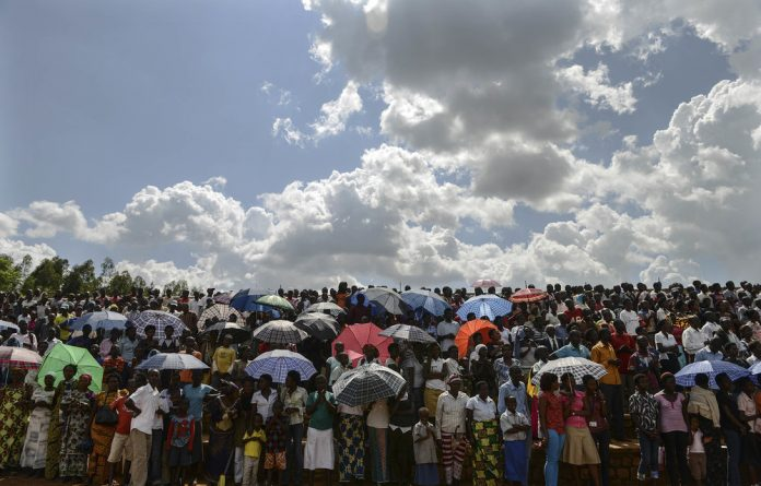 Guiding light: A crowd watches the passing of the Kwibuka Flame of Remembrance in Kigali