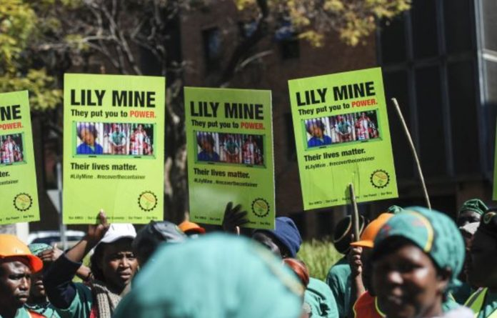 Miners protest outside the mineral resources department's offices in Pretoria in 2016.