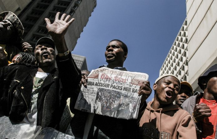 Sickening: Jacob Zuma's supporters gathered outside the court on the day Judge Willem van der Merwe acquitted him of rape.
