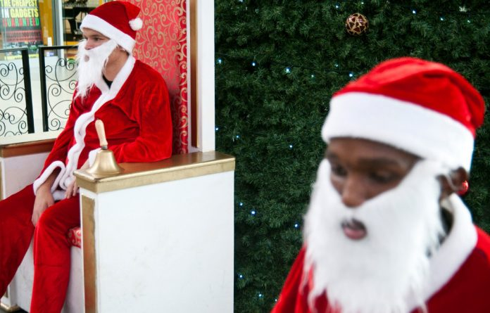 Hot costumes and babies in smelly nappies are some of the downsides of a job as a mall Santa.