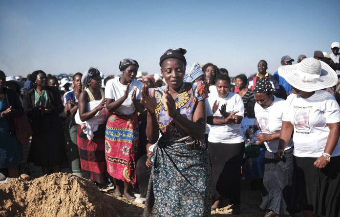 Silvia Maphosa is buried after he and others died during violence in Harare a day after the elections. A commission has completed its investigation into the bloodshed.